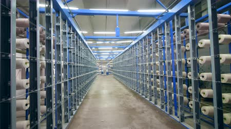 haft : Many racks with spooling threads at a textile factory. Wideo