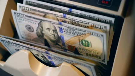 mechanically : Dollar banknotes are getting counted by the machine Stock Footage