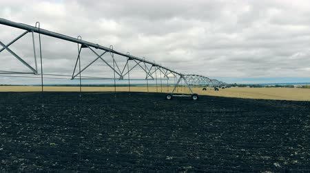 fertilizing : Agriculture field with a irrigation mechanism set up on it