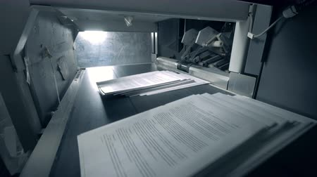 ofset : Piles of paper getting on automated conveyor, typography facility.
