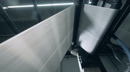 nyomdai : Newspaper sheets rolling on a typographic conveyor, automated machine.