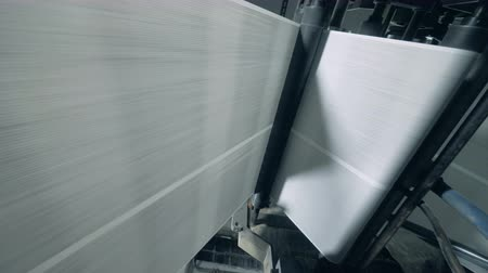 impressão digital : Rollers move long sheets, typographic equipment. Stock Footage