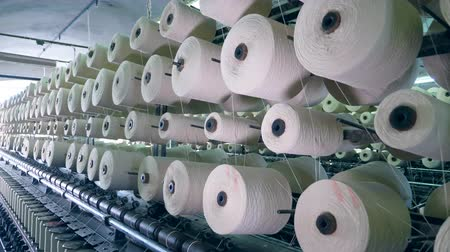 編まれた : Textile equipment spins bobbins with threads, coiling. 動画素材