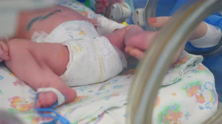 intensive care unit : Infant in a diaper is lying in the box after a medical procedure