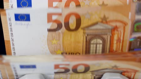 fiscal : Banknotes of euros are moving inside of a counting device Stock Footage