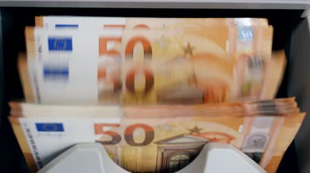 cash machine : Money-counting machine with euros in it