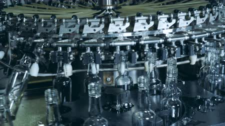 unfilled : Empty bottles are getting relocated by the machinery complex Stock Footage