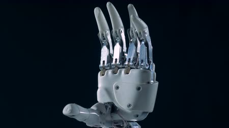 prosthesis : Metal bionic hand, close up. Real cyborg hand in motion.