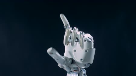 humanoid : Automated hand bending fingers, close up. Futuristic robot concept.