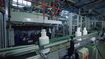 polymers : White plastic vessels are removing each other from the conveyor