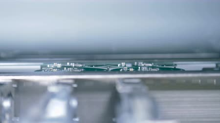 automated : Microchips assembled at a factory, close up.