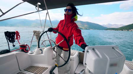 Sailing boat is being managed by a woman