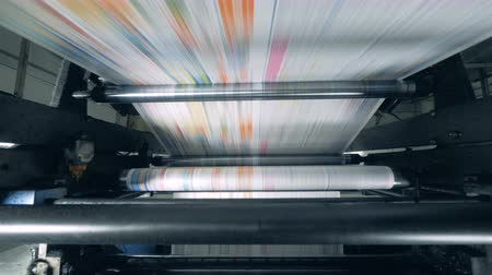 impressão digital : Paper rolling on a line at printing office, factory equipment. Stock Footage