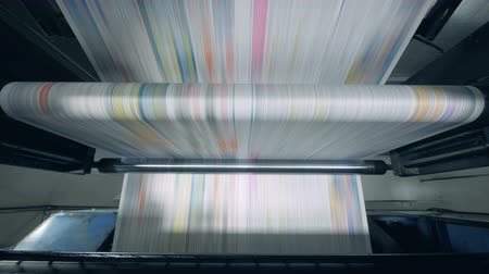 Automated conveyor moving printed newspaper at a factory. Stock mozgókép
