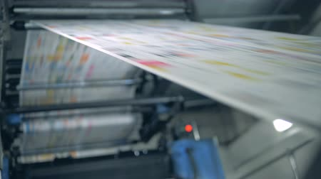 nakladatelství : Print office equipment working with newspaper sheets, automated technology.