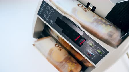 Counting machine is calculating euros