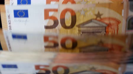 euro banknotes : Euro money are getting counted automatically