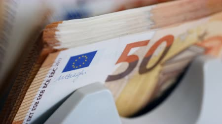 eur : Close up of euro banknotes while being counted