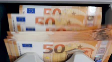 eur : Stacked euro banknotes are getting calculated