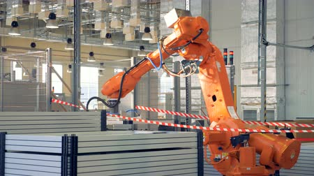 Modern Industrial Robot arm working in factory. Stockvideo