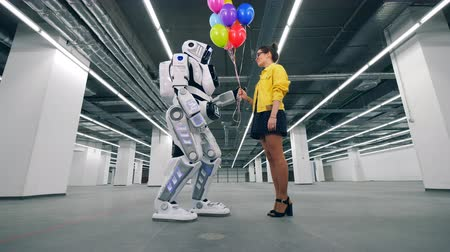 bot : A girl gifting colorful balloons to her friend robot.