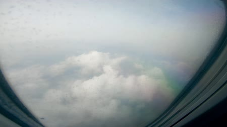 Dense clouds are seen from and airplane window 影像素材