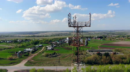telephone tower : One transmitting tower working on a field.
