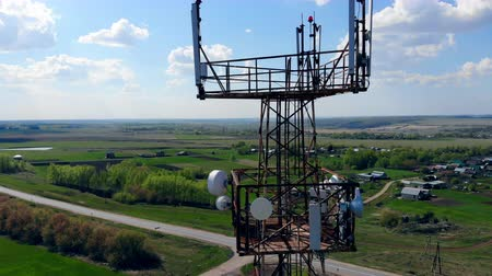 Cellular tower working on a field, transmitting signals.