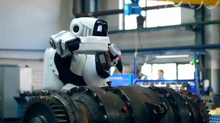 android : Industrial mechanism is being drilled by a cyborg