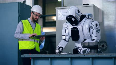 sintético : Factory worker is controlling a robot polishing metal