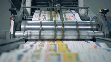 nakladatelství : Printing newspapers in typography. Transporter is relocating folded newspapers