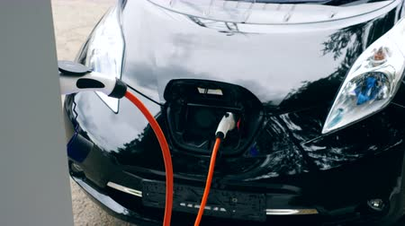 кабель : Car charger works with electromobile.