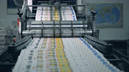 sahte : Printed magazines are moving along the rolling machine