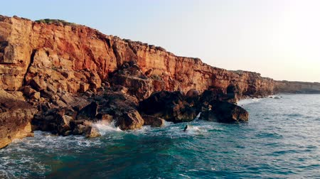 litoral : High cliffs and blue sea on a sky background. Stock Footage