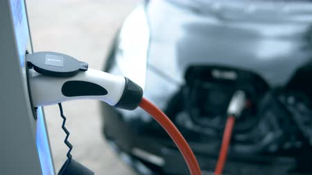 recharging : Charging equipment works with electric car. Stock Footage