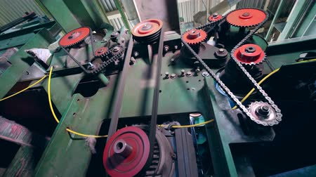 sentetik : Metal gears work on a machine at a textile plant.