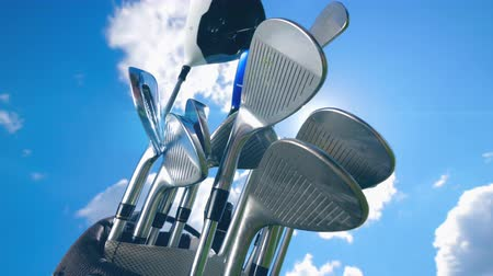 golfové hřiště : Many golf clubs on a sky background.
