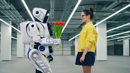 cortes : Young lady is getting tulips from a robot