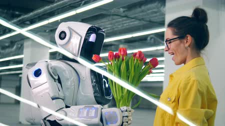 artificial flower : Smiling lady is taking flowers and hugging a cyborg Stock Footage