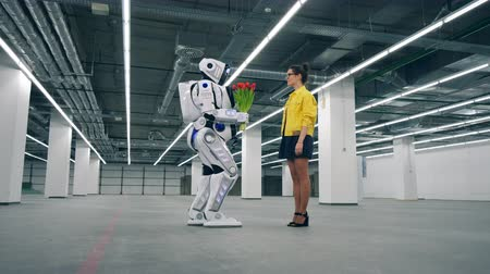 android : Lovely lady is accepting flowers from a human-like robot