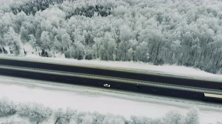 nordic countries : Cars driving along freeway during winter. Aerial. Stock Footage