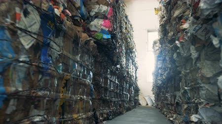 bales : Factory warehouse full of garbage, close up. Stock Footage