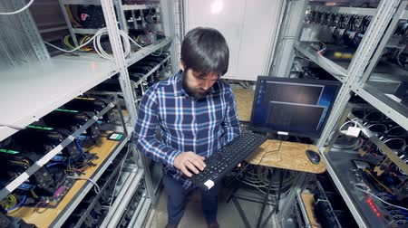 block chain : One man at a mining farm, top view.