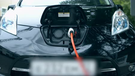recharging : Electrocar is getting recharged