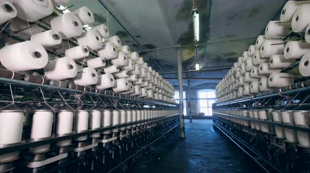 clothes line : Plenty of sewing spools in the garment factory. Textile factory equipment.