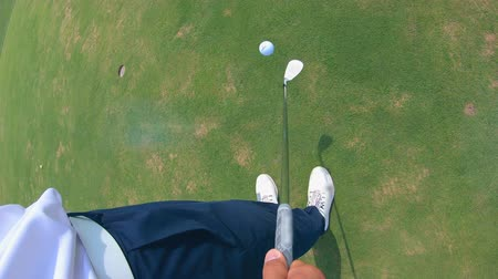 golfjátékos : First-person view of a ball getting juggled with the golf club