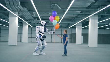 robotica : White cyborg giving balloons to a girl, side view.