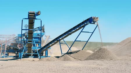 taş ocağı : Rubble crusher works at a quarry. Mining industry concept. Stok Video
