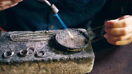 skillful : Pieces of silver jewelry are getting fixed by the goldsmith Stock Footage