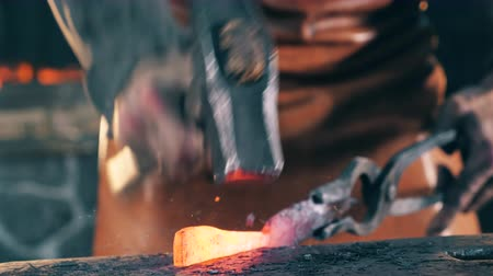 kowalstwo : Process of knife shaping on an anvil at a forge.